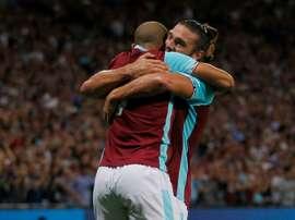 West Ham midfielder Sofiane Feghouli celebrates a goal with striker Andy Carroll. AFP