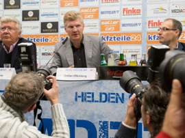 Ex-Germany international Stefan Effenberg (C) speaks during a press conference to present himself as new coach of German second division Bundesliga football club SC Paderborn on October 14, 2015 in Paderborn, northwestern Germany