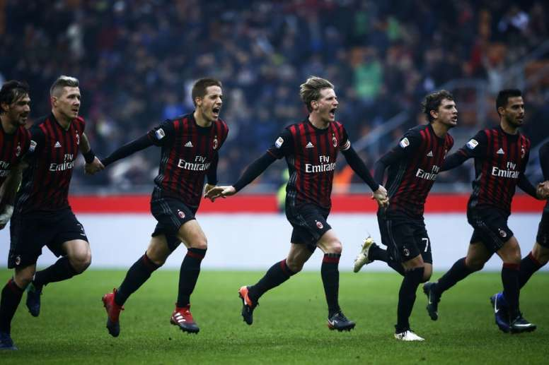 AC Milans players celebrate after winning the Italian Serie A match against Crotone on December 4, 2016 at the San Siro Stadium in Milan