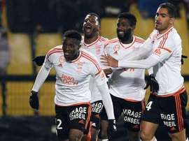 Benjamin Moukandjo celebrates with his Lorient teamamtes after scoring a goal during in Ligue 1. AFP