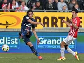 Edinson Cavani (left) scored again as Paris Saint-Germain beat Ligue 1 strugglers Nancy 2-1