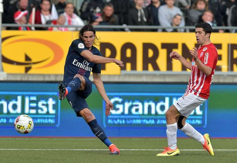 Edinson Cavani (left) scored again as Paris Saint-Germain beat Ligue 1 strugglers Nancy 2-1