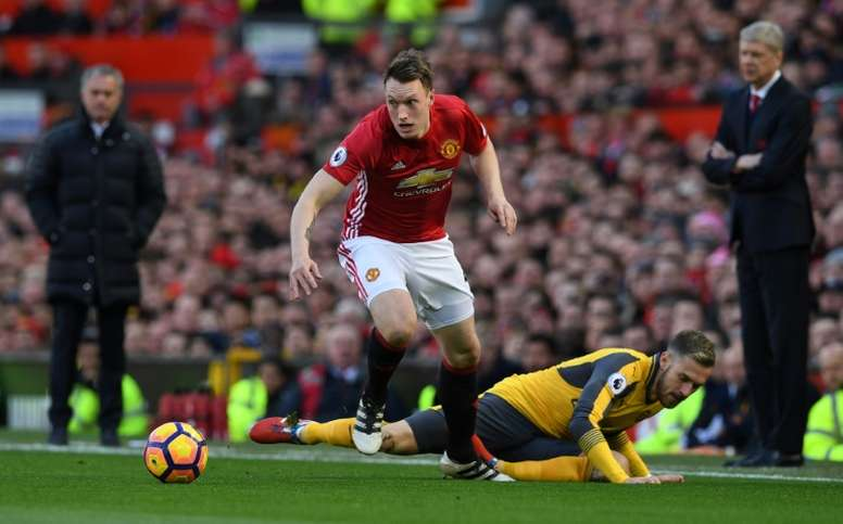 Phil Jones in action against Arsenal. AFP