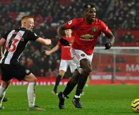 Van Persie aimerait que Pogba choisisse. AFP