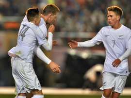 New Zealands Chris Wood (C) celebrates scoring a goal with teammates during a friendly match in Tokyo