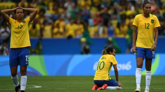 Brazils Marta (C) is dejected after losing a penalty shoot-out to Sweden in their Olympic womens semi-final football match