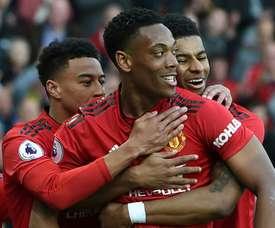 United vence e coloca fogo na briga pela Champions. AFP