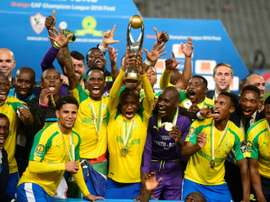 Mamelodi Sundowns players celebrate after winning the CAF Champions League . AFP