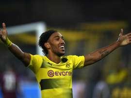 Aubameyang's hat-trick sent his side top of the Bundesliga. AFP