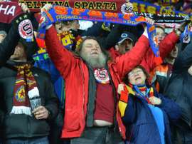 Fans of Sparta Praha wave their scarves before the UEFA Europa League Round of 16 first-leg football match between Sparta Prague and Lazio Rome in Prague, Czech Republic on March 10, 2016