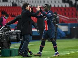 Pochettino celebrates his first win, 3-0 against Brest, with striker Moise Kean. AFP
