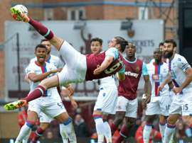 West Ham United's Andy Carroll kicks an unsuccessful shot during their English Premier League match against Crystal Palace, at The Boleyn Ground in Upton Park, east London, on April 2, 2016