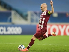 Iniesta sidelined for four months with leg break. AFP