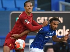 Van Dijk (L) was happy to be playing despite the goalless draw with Everton. AFP