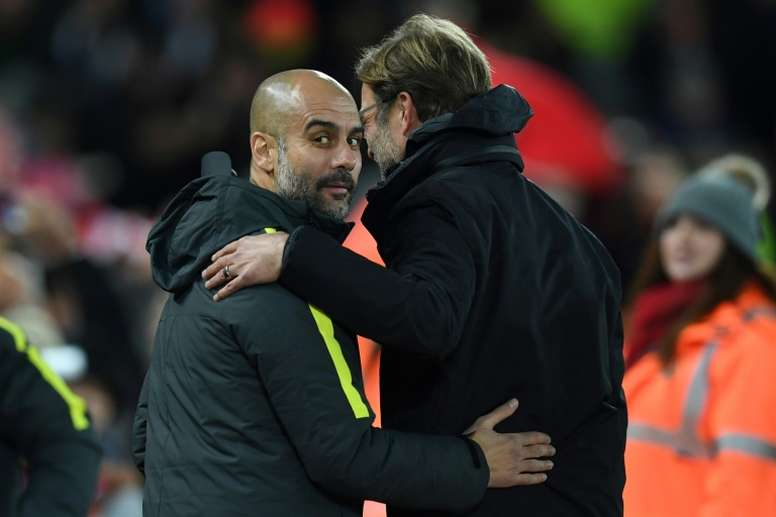 Klopp and Guardiola are expected to go head-to-head for the title. AFP