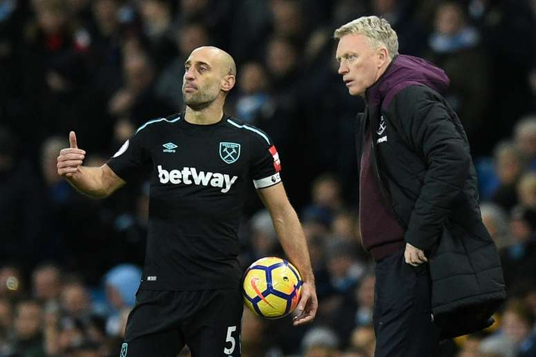 Zabaleta pictured with former West Ham United manager David Moyes. AFP