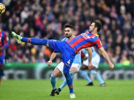 Luka Milivojevic got over his penalty woes by notching two against Arsenal. AFP