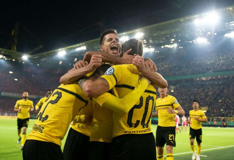 Dortmund forward Maximilian Philipp celebrates scoring with his team-mates. AFP