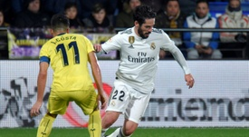 Isco (R) hasnt started a league game since Santiago Solari took over as Madrid. AFP