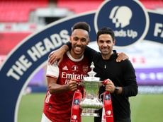 Mikel Arteta thinks Aubameyang (L) will stay at Arsenal. AFP