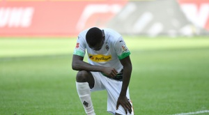 Gladbach go third as Thuram takes a knee in US killing protest. AFP