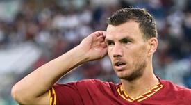 Dzeko podría cambiar Roma por Milán. AFP