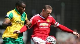 Sebastien Bassong (L) has signed for Peterborough. AFP