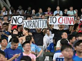 Hong Kong demonstrators unfurled banners and sang a protest song during the match. AFP