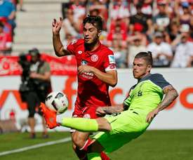 Mainz midfielder Suat Serdar (L) and Liverpools defender Alberto Moreno fight for the ball in Mainz, central Germany, on August 7, 2016