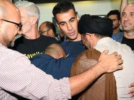 Refugee footballer makes triumphant return to Australia