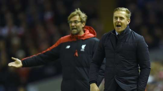 Monk and Klopp managing in 2016. AFP