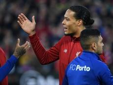 Liverpool can win dream double, says Van Dijk. AFP