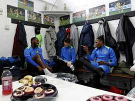 Sutton United players sit in the dressing room. AFP