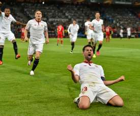Sevillas defender and captain Coke (R) celebrates after scoring a goal during the UEFA Europa League final football match between Liverpool FC and Sevilla FC in Basel, on May 18, 2016