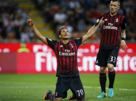 AC Milans forward Carlos Bacca from Colombia (L) celebrates after scoring on October 2, 2016