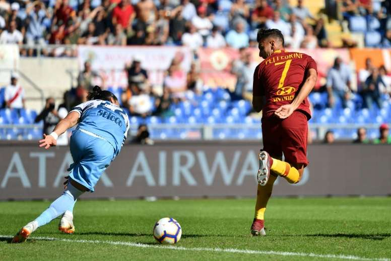 Pellegrini (R) will get a new and modified Roma contract. AFP