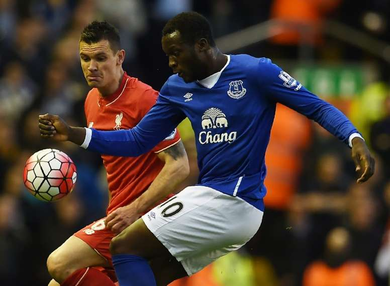 Liverpool's Dejan Lovren (L) fights for the ball with Everton's top scorer this season, Romelu Lukaku, during their English Premier League match, at Anfield in Liverpool, on April 20, 2016