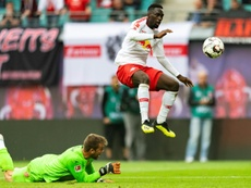 Jean-Kevin Augustin (R) was caught using his phone before a Europa league match. AFP