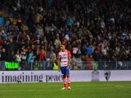 El Arabi dio aire al Granada con un hat trick al Levante. AFP