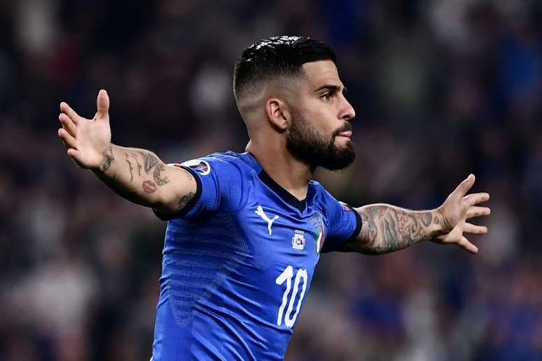 Lorenzo Insigne celebrates after scoring for Italy. AFP