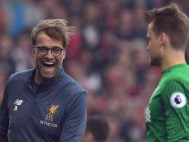 Mignolet is set to stay at Liverpool. AFP