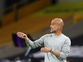 Guardiola says Man City squad is stretched to its limit. AFP