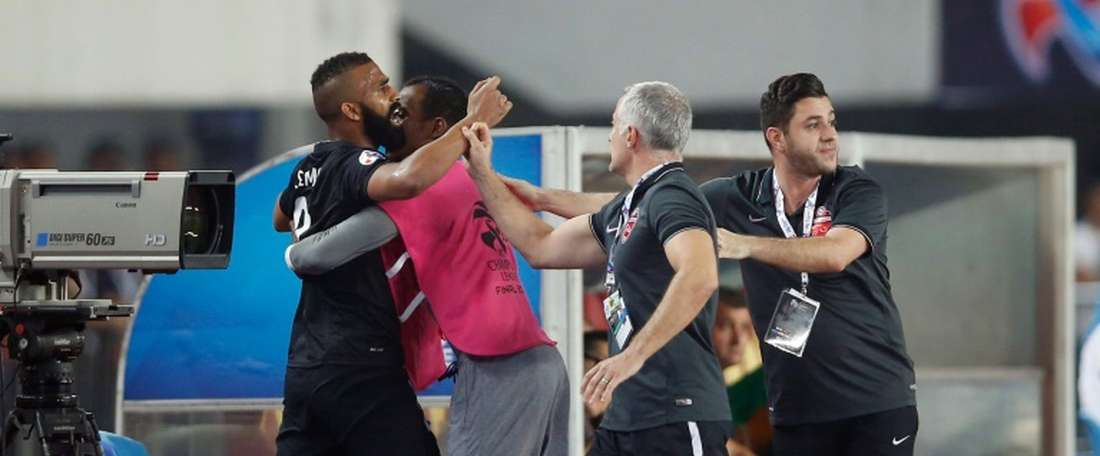 Salmin Khamis (L) of the UAEs Al Ahli is restrained on the sidelines after being shown the red card during their AFC Champions League final match against Chinas Guangzhou Evergrande, in Guangzhou, on November 21, 2015