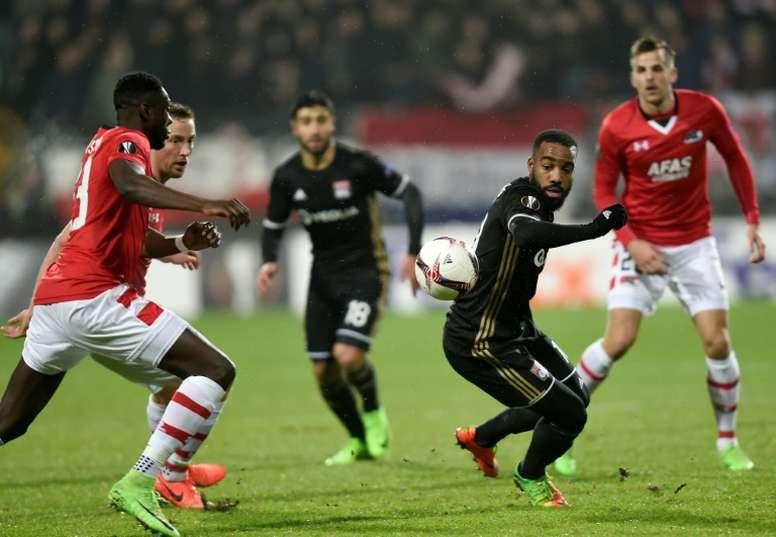 AZ Alkmaar's defender Derrick Luckassen and Lyon's forward Alexandre Lacazette. AFP