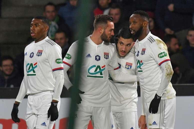 Rayan Cherki (2R) had an outstanding performance in the French Cup. AFP