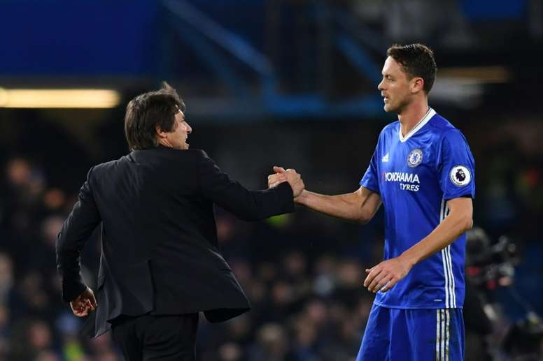 Matic (R) is congratulated by Chelsea manager Antonio Conte after a game. AFP