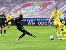 Moussa Diaby fires Bayer Leverkusen ahead against Borussia Dortmund on Tuesday. AFP