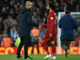 Pep Guardiola cost Manchester City points against Liverpool. AFP
