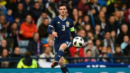 Andy Robertson will miss Scotland's trip to Kazakhstan. AFP