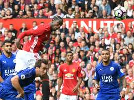 Simpson (R) can only watch on as Pogba powers a header home from a corner. AFP